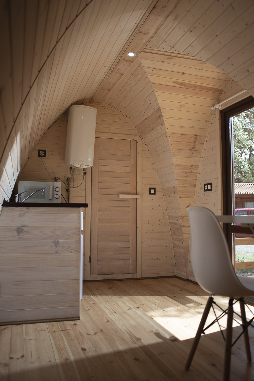 cocina pod de madera camping